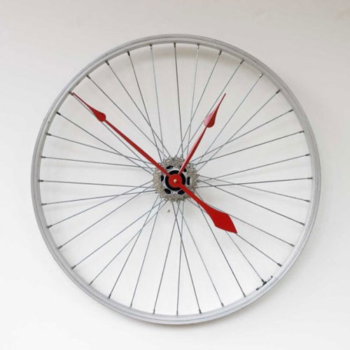 a clock made from a bicycle wheel via The Dot Creative Design Blog