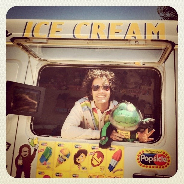 "Talk about living the dream! Hey Amber Rae have you met The Ice Cream Man? #newportfolk  (Taken with instagram) He's a true inspiration. According to his site:   In the summer of 2004, Matt Allen was behind the wheel of a 1969  Chevrolet Step Van, roaming the streets of Ashland, Oregon in search of  adventure. Armed with a video camera and an endless supply of frozen  treats, he was determined to become not only the most famous ice cream  man in Ashland, but the most famous ice cream man in the world. As that  summer came to a close, Allen's mission of entertainment evolved into a  greater calling. He began giving away his ice cream for free, starting  with an ice cream social for the residents of Ashland and quickly moving  to his hometown of Long Beach, California to expand the simple idea of  free ice cream into the phenomenon it is today.  Five years, four national tours, and over 300,000 free ice creams later,  Ice Cream Man has come to represent the power of a dream. ""This is  about getting people to think about things a bit differently, proving  that you can do anything with your life,"" says Allen, a veteran  adventurer whose feats have included hiking from Mexico to Canada and  biking across the country to raise money for breast cancer groups. ""I  want to give away ice cream. It's that simple. I can't be the only one  who thinks this is a good idea. Why not bring all of these like-minded  people together to do great things?"""