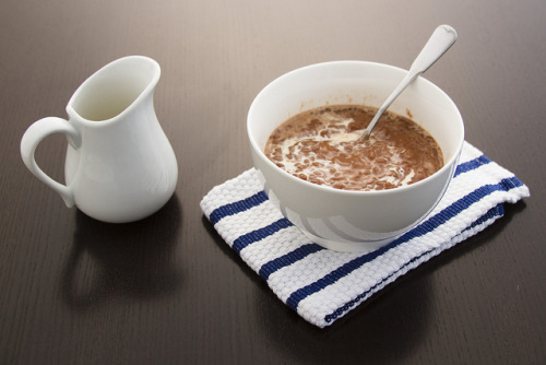 vivafilipinas:  Champorado Chocolate Porridge  Tsampurado/Champorado is a sweet chocolate rice porridge made by boiling sticky, glutinous rice with cocoa powder, giving it a distinctly brown color, and adding milk or sugar or condensed milk to make it sweeter. It is sometimes eaten together with salty dried fish locally known as tuyo. It is commonly served during breakfast, but it's also perfect for cold, rainy weather - just like today. Stay safe and stay warm!