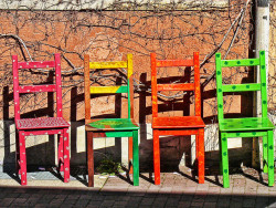 Four colored chairs detail by Daniel Schwabe on Flickr.