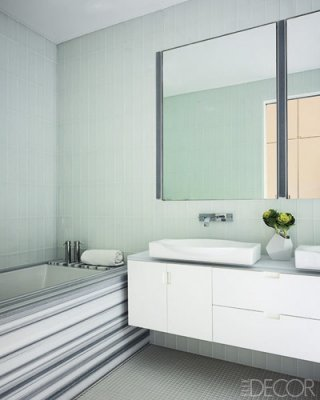 The walls and floors of the master bath are sheathed in  glass tiles; the tub surround is marble, and the faucets are by Dornbracht. Photographer: Tim Street-Porter