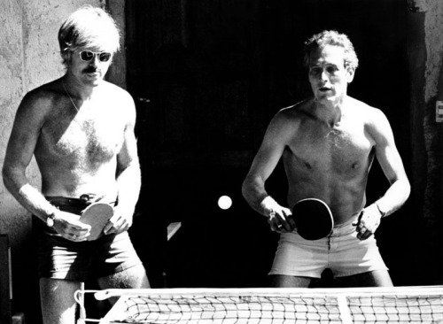 Paul Newman, Robert Redford and filmmaker George Roy Hill (not pictured) play table tennis between takes on the set of Butch Cassidy and the Sundance Kid, Mexico 1968.