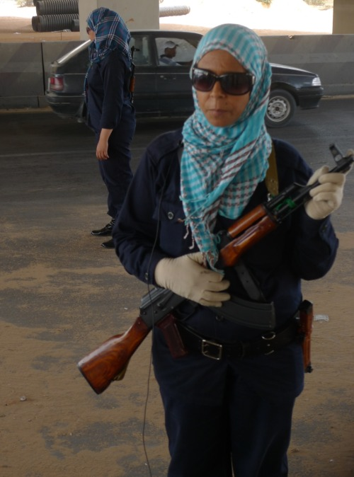 fuckyeahmarxismleninism:  THE REVOLUTIONARY WOMEN OF LIBYA: Mother and 17 year old daughter who are an example of the masses of Libyan women who have volunteered to take up the government weapons training and government issued weapons on offer and to run one of the very few checkpoints in Tripoli. Masses of women are also fighting on the frontline.  All of this mother's sons are fighting on the frontline and in tears she explained to us that she would be happy to give her blood to protect her beloved leader Muammar Gaddafi and country who she said has always worked hard for the liberation of Libyan women. She called for death to NATO and told them to face the people on the ground instead of being cowards in the sky. She said every Libyan who dies is her child, that it is why it is her duty to do everything in her power to defend her family, people, leader and country. The 17 year old sister said Muammar Gaddafi is her father because of all he has done for the liberation of women in Libya. She said her mother brought her up to be strong and stand up for her people. By Lizzie Phelan, photo by Sukant Chandan More of Lizzie's Libya Photo Diary