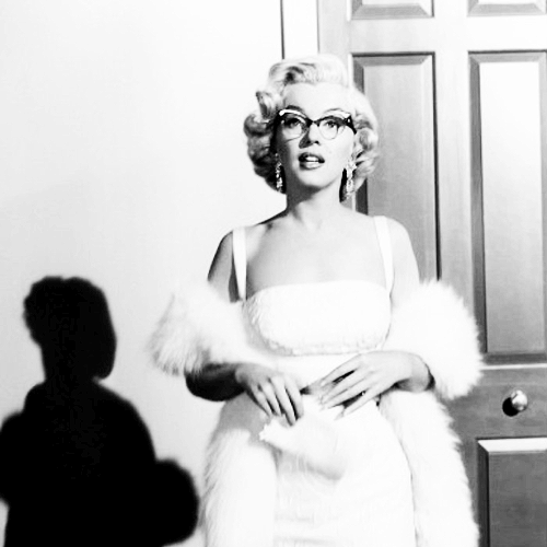 Marilyn monroe and her cat eye glasses.