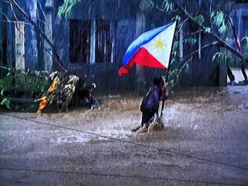 juanrepublic:   During the onslaught of Tropical Storm Juaning in Albay, 12-year-old Janella Lelis braves the flood to save a Philippine flag Francisco Pena Lozano  Priceless A few days ago, I posted a blog entry about our slain and decapitated soldiers in Sulu after their clash with the Abu Sayyafs and how I admire their courage and love for our country. We are all called to be a bayani even in our own, small, little ways and one of which is to respect and give honor to our flag. And this young girl did on the photo more than that. She braved the flood during the height of Tropical Storm Juaning to save a Philippine flag. I watched the evening news earlier and it saddened me learning that their house and all their stuff were all wiped out by the raging flood. She and her family are now homeless and are temporarily living with a relative. She was not able to save their house and all their stuff, but she was able to save our flag, our country's symbol, from the flood. How sweet was that? I admire you Janella. You are indeed a hero. I just hope that there are still other Janellas among our youngsters today. I hope that the spirit of patriotism is still burning in the hearts of Filipinos today. It's just sad to hear people who have forgotten our national anthem after finishing school (or even in College where the flag ceremonies are seldom done). Or to see people, especially in the malls, not pausing and giving respect whenever the national anthem is played. Or people who just treat our flag as an ordinary piece of cloth. How about you? How far will you go for our country? Viva Filipinas! Padayon! Elsewhere: Bata, lumusong sa baha para isalba ang Philippine Flag (video)