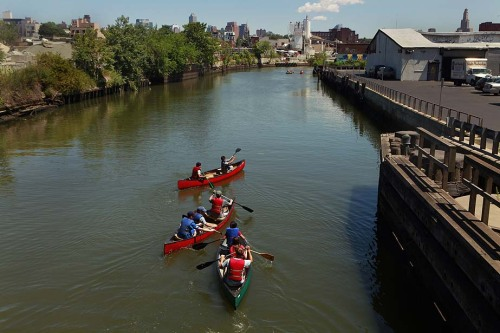 "Brooklyn's Gowanus Canal, labeled ""one of the most contaminated bodies of water in the nation,"" isn't just a filthy Superfund site. To urbanites, it's a little piece of the outdoors. Photo: Summer camp students from Battery Park City in Manhattan. The Gowanus Canal was designated a Superfund site in March 2010 and will take years to clean. View more photos on Framework. Credit: Carolyn Cole / Los Angeles Times"