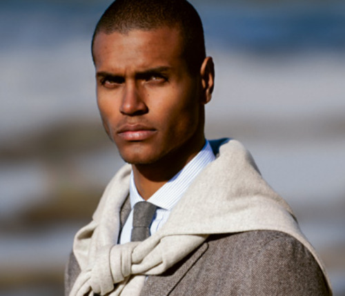 "thisfits:  Brunello Cucinelli A/W 2012 It's good seeing someone dark-skinned like myself modeling Cucinelli. I've developed an appreciation for his collections—even going so far as to pick up a few lookbooks from past seasons as inspiration for my own wardrobe. The styling, the cut of the clothes and especially the textures are very appealing, but I've always wondered how the muted palette he favors would look on a guy like me.  The answer, in my mind, is ""not that great."" Even if you're model handsome, like this dude is. If you have a low-contrast complexion - light skin, light hair - I think the palette of Brunello Cucinelli is one you should study carefully. I don't think anyone does a low-contrast color pallette better than him. Light gray, light blue, light brown and cream are about it, color-wise, and it always looks tremendous. If, that is, you have coloration like Cucinelli's. If you don't, whether you have dark skin or light skin and dark hair, the colors will not flatter. Instead, they'll look dull and washed out. Then, the texture is all that's left."