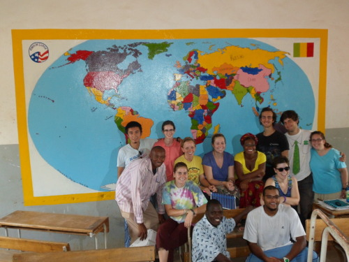 World Map mural & education trainees.  Damn we look good. Gotta give mad props to the BCampers for doing alot of the overtime work. And our Program Trainers Yaya & Sylvan for just being grobenet (stylin').   We painted this map in a 6th grade classroom.  It's a crucial grade for Malian students because it's the last of the premier cycle (1st thru 6th grade) and by then they are expected to have learnt to read & write in French.  This is often not the case because despite the fact that French is the national language in Mali, most of its populace speak Bambara or one of the 12 other major local languages in their homes.  There is currently an unacceptable drop out rate between 1st & 2nd Cycle (7th-9th grade), for well…many reasons.  From 7th grade onwards, all formal instruction will be in French.  If a student doesn't know it by then, well its a bana (finished) for their education.  The map itself is in French, and the hope is that ni allah sonna (god willing) the students in that classroom will be able to read & learn from it.  Ending on a positive note though:  It does look much better than a blank wall, doesn't it?