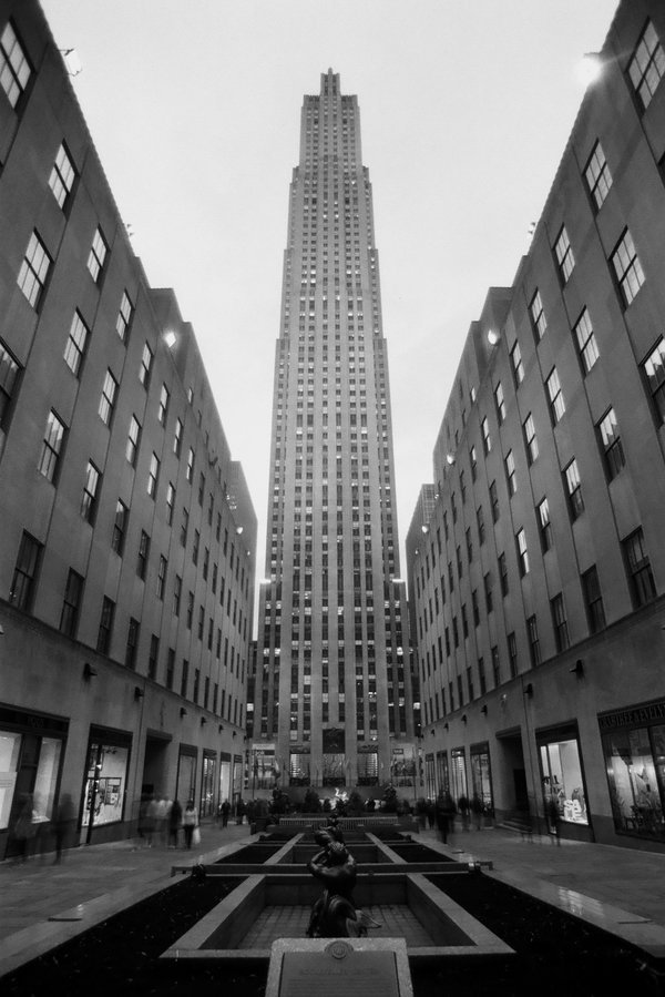 "decoarchitecture:  Rockefeller Center, NYC, New Yorkby roguesamus Another photo that demonstrates the perfect proportions of the architecture and space. From the photographer:  Rockefeller Plaza looking East near 5th Ave. I went back and shot this on film during my March trip to the East Coast.Film Scan! Settings & Equipment:Minolta Maxxum 5, Tokina 19-35mm, Ilford Panf Plus 50 ISOF/16, 2""Manhattan, NYC, USA. March 2011"