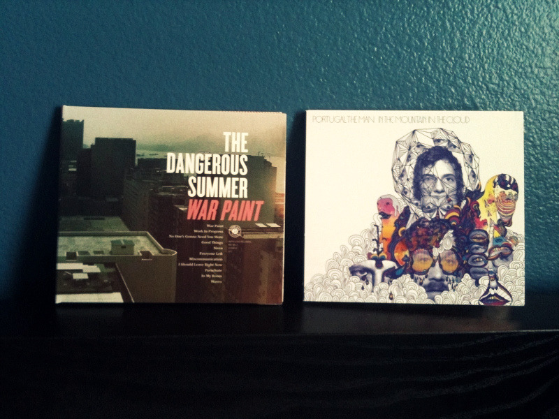 NEW CDS: The Dangerous Summer - War Paint [2011] Portugal. The Man - In The Mountain In The Cloud [2011] Since my local Best Buy had neither of these albums in stock I ordered them online so that I could still use my gift card. A week later and I finally had them! Great story, right?! Well, War Paint has successfully fulfilled my expectations and I might go as far to say that I like it more than Reach For The Sun… but only time will tell. As for In The Mountain In The Cloud, I haven't listened to it as much. I like it but compared to their older material, I don't like it as much. Altogether, I'd say I'm pretty satisfied.