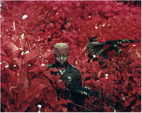 tobia:  RICHARD MOSSEVintage Violence, North Kivu, Eastern Congo, 2011From the Infra series.  (Courtesy of Jack Shainman Gallery.) Am getting much inspiration from Mosse's hypnotic photography, particularly those from his Infra series. The vivid color and intense portraits are transfixing. Ironic how I'm just now seriously getting into his work when I have commenced a monochromatic piece.