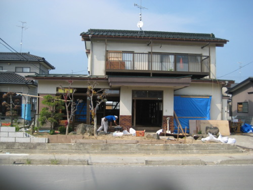 "Please read: This is Suda san's house (located across from Sato-san's). ""On our last day, Suda-san told us how his daugther had passed away from the tsunami. His daughter was 8 months pregnant when the tsunami struck. As water started to fill the first floor, she was too slow and couldn't reach the second floor. Mr. Suda was on the stairs, trying to pull his daughter's hand as the waters rushed in, but the rubble hit their arms and she lost her grip. He said he can still hear her voice shouting, ""Daddy, help, help…"" But there was nothing he could do. He lost both his daughter and grandson within seconds. He said that scene keeps on repeating in his mind over and over again. It's like a dream and he still wishes to wake up from it. We helped him to clear out his house and prepare it for renovation; as he is trying to make a restart with his wife, but it is not easy."" (slightly adapted excerpt from Stephan Smithidorff, O.M. Japan) On that last day, my team and I wept inside for our friend, Suda-san. Seeing this grandfather straining every day to pull out floorboards and knock down walls that couldn't save his grandson or his daughter just felt wrong. What can you say to someone who's lost so much? To say, ""be strong"" would be mocking and we don't get to talk to him a lot. So, I kept on asking, ""What can we do?"" So, we empathized; we worked and sweat alongside him; we wept inside. It's not the Japanese way to be emotional so firm handshakes replaced hugs and, then in two weeks, we said goodbye. But, something about being in his space, talking to him face-to-face, and seeing the grief etched in his face moved us deeply. Suda-san, we are both God's creation; we share the same humanity and I feel part of your grief. I pray that you come to know God's joy and hope. Press on, because there is hope.   Continue praying for people like Suda-san, who has to work on his own house (because the government is too occupied with worse-hit regions) and look bleakly at the future. Their grief is on-going, so should our prayers."
