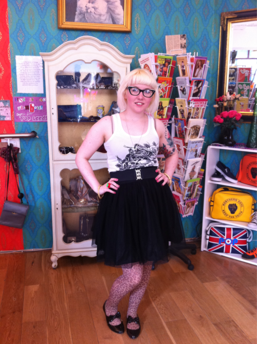 Wearing: old black net skirt, xam tattooist vest by mama's gun, belt from rose and co, leopard print tights from god knows where, Fred perry necklace, bamboo bangles, h&m apple ring, spex and the city glasses.  Hair: down for once!!!  Feeling: all toothachey! But pleased that my tumblr app is working again!