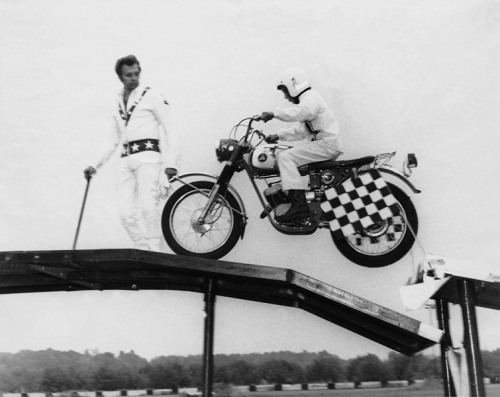 A young Kelly Knievel under the watchful eye of Dad.