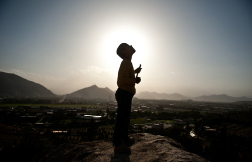 An Afghan boy eyes kites from a hill in Kabul on May 13, 2011. (Manan Vatsyayana/AFP/Getty Images)  #
