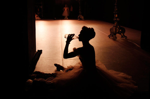 Moscow, Russia: A ballerina takes a drink during the Cuban National Ballet gala concert at the Bolshoi theatre Photograph: Denis Sinyakov/Reuters