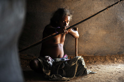 Vakarai, Sri Lanka: A Sri Lankan  aboriginal (Veddha) aims his bow and arrow during celebrations to mark  World Indigenous People's day Photograph: Ishara S Kodikara/AFP/Getty Images