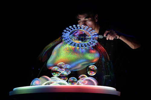 Beijing, China: Canadian bubble artist Fan Yang performs during the Gazillion Bubble Show  Photograph: Jason Lee/Reuters