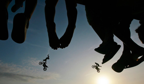 Columbo, Sri Lanka: Spectators watch as freestyle motocross stunt riders from Red Bull X-Fighters perform Photograph: Dinuka Liyanawatte/Reuters