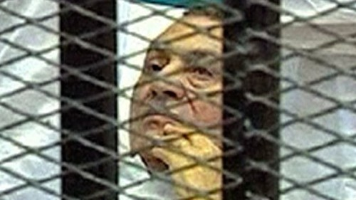 "Hosni Mubarak trial begins on not exactly the best of terms You're seeing correctly. That is former Egyptian dictator Hosni Mubarak, in a cage. He's actually standing trial from a cage, and he's in a hospital bed. His trial started today, and it's surprising a lot of Egyptians, who figured he'd use health problems as an excuse to not show up. Mubarak has denied all of the charges against him. We'll be careful not to drop a reference to The Smashing Pumpkins' ""Bullet With Butterfly Wings"" in here. source Follow ShortFormBlog"