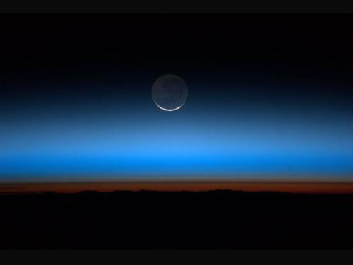 "lookhigh:  Sunset, Moonset On Sunday, July 31, 2011, when Expedition 28 astronaut Ron Garan aboard the International Space Station looked out his window, this is what he saw: the moon. And, he saw it 16 times. Said Garan, ""We had simultaneous sunsets and moonsets."" For Garan and the rest of the station crew, this extraordinary event is a daily occurrence. Since the station orbits the Earth every 90 minutes, each day the crew experiences this about 16 times a day. (NASA) (HT: The Picture Show)"