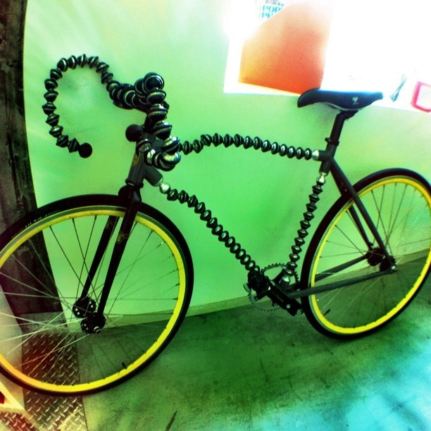 photojojo:  On that note, check out this Gorillapod-ish bike our buddy Doc Pop spotted at Joby today! via docpop