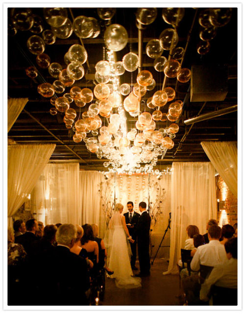 This is GREAT! do it yourself chandelier, it can be customized for different events, hell i would even have one at home! Click here to find out how to make on your own!
