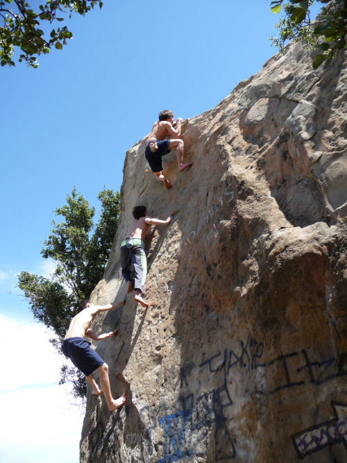 """Barefoot human centipede on Mommy's Boys, Stoney Point, CA. Marcus Moreno, Galen MacDougall, and Tim Transon leading the way up Mommy's Boys at Stoney Point."" (Photo by Soul Climbing)"