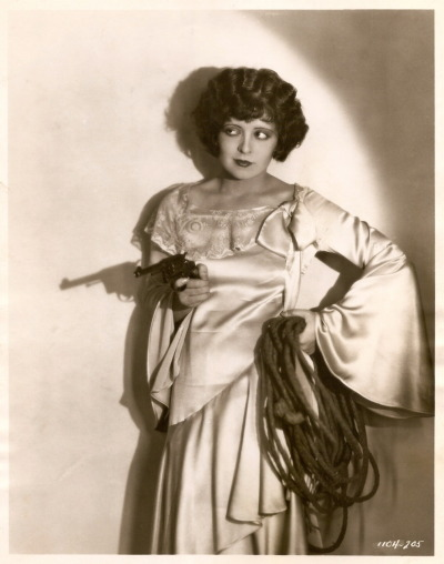 clarabowarchive:  Clara Bow with gun & rope photographed by Gene Robert Richee for Get Your Man, 1927. Alternate shots previously posted: http://clarabowarchive.tumblr.com/post/3624783688 http://clarabowarchive.tumblr.com/post/3623994762