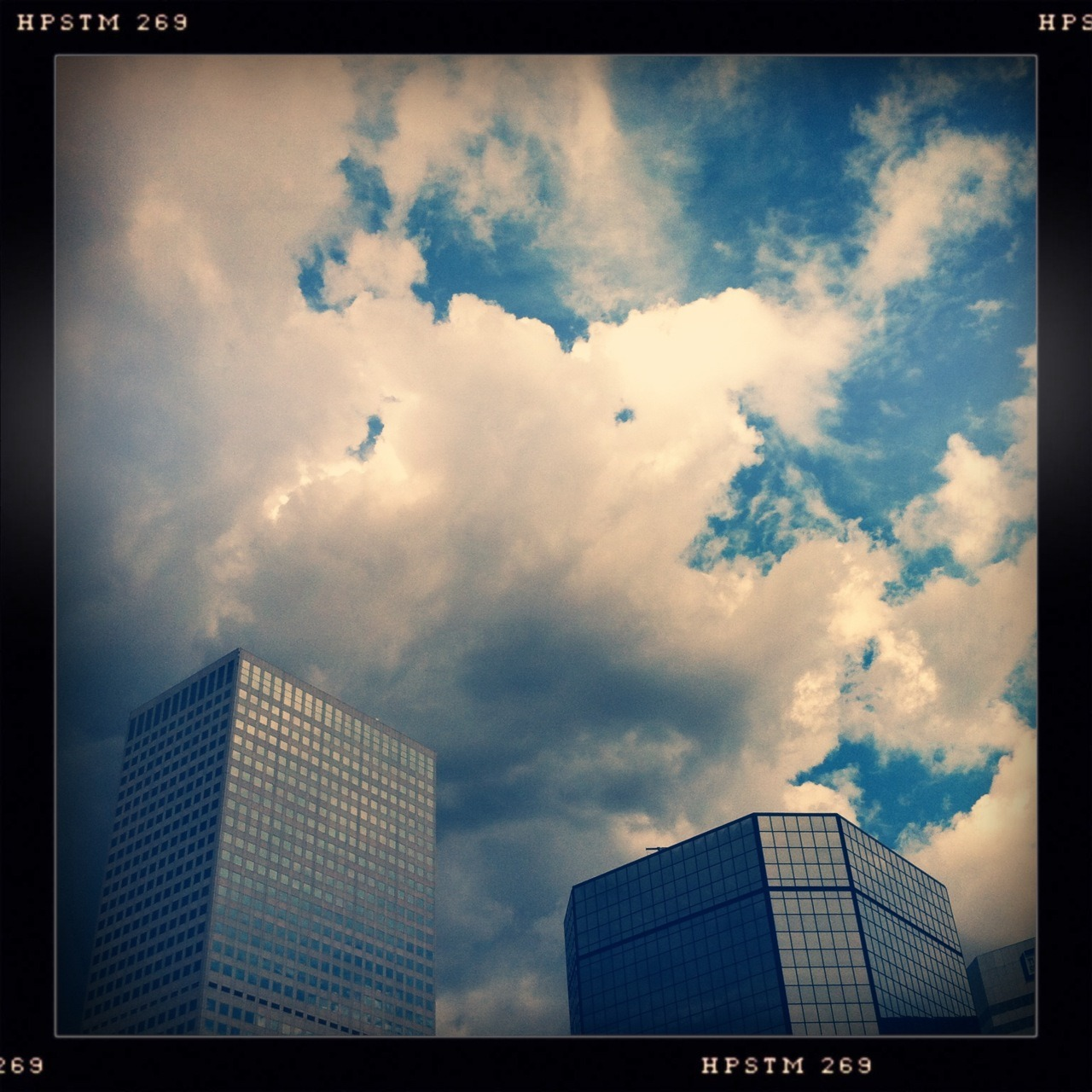 Storm Over Downtown Taken with Hipstamatic, Tejas Lens, Pistil Film, No Flash.