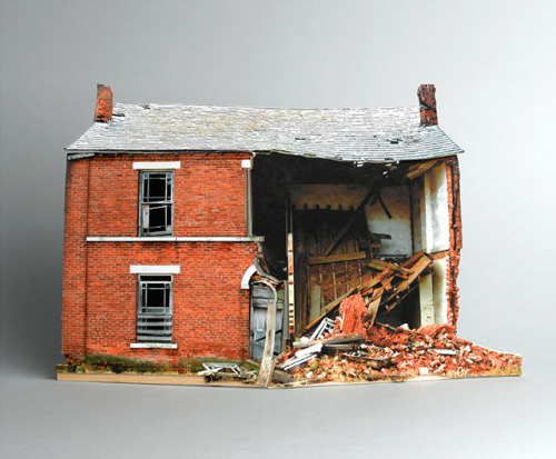 The series Broken Houses by Ofra Lapid, is based on photographs of abandoned structures neglected by man and destroyed by the weather. The photographs are found on the internet and used to create small scale models. Afterward the models are photographed again, omitted from their background and placed in gray.