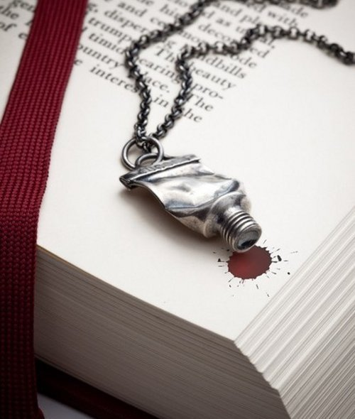 "wickedclothes:  A silver paint tube necklace. From the creator: ""The inspiration behind this neckpiece comes from the creative people around me. It's a small tribute to all of those who make our lives better and more interesting just because they do what they do. Their talent knows no borders and touches us all regardless of our races and cultures, even when, or especially when, their work goes against the grain."" Found on Etsy.  Please and thank you."