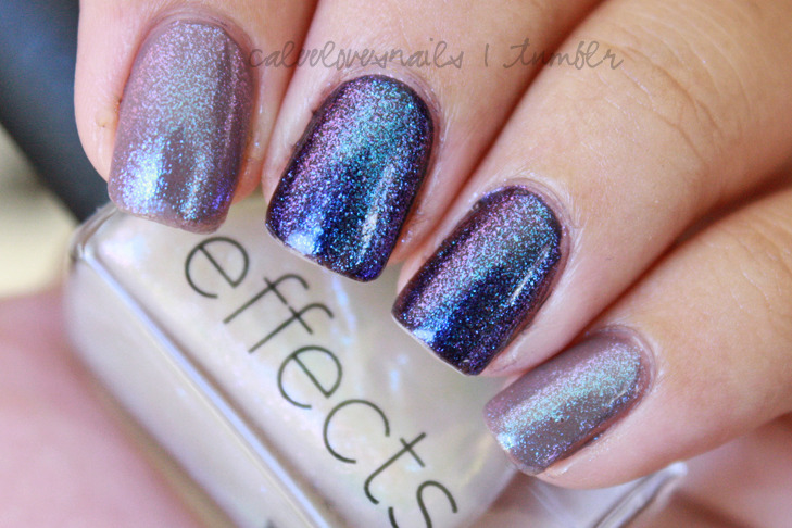 caleelovesnails:  I've been on a glitter craze lately! I can't resist. What I have on is Essie's Merino Cool on my index & pinky finger & OPI - Ink on my middle & ring finger. All topped with CND's Sapphire Sparkle! That stuff goes on your fingernails like MAGIC. Look at how gorgeous the glitter effect is! I'm so in love.