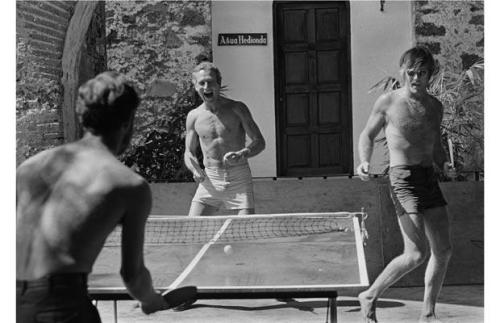 Paul Newman, Robert Redford and director George Roy Hill play table tennis during a break in filming Butch Cassidy and the Sundance Kid in Mexico, 1968. As photographed by Lawrence Schiller.