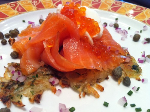 Smoked norweigian salmon with potato galette, capers, sour cream and salmon caviar at Evo Bistro.