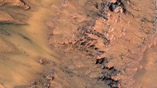 proofmathisbeautiful:  MARS MAY HAVE FLOWING SALTWATER!! (via CNN) - Scientists have found new evidence for possible  saltwater flows on Mars. The discovery was announced at a NASA news  conference Thursday. Alfred McEwen, lead author of the Science journal study showing these  observations, and his team have been observing Mars using the HiRISE  camera aboard NASA's Mars Reconnaissance Orbiter. His team has identified features on some slopes of the planet that appear to fade in the winter and come back in the spring.