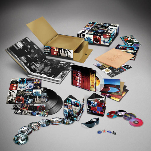My, what a large…ACHTUNG BABY 20th Anniversary box set U2 have. Multiple versions, but the core seems to be 6CDs/4DVDs.  Both Achtung Baby and follow-up/sequel Zooropa are going to be included.  What's on the other 4 CDs?  They've not quite said yet, although there are a ton of b-sides (at least one disc's worth) from the singles off that album, and that's even before you get to the remixes.  There's a lot on offer, although it Zooropa is getting short shrift in terms of the press on this so far.  Details here at U2's site.  For a tracklisting, visit the fine folks over at Slicing up Eyeballs.