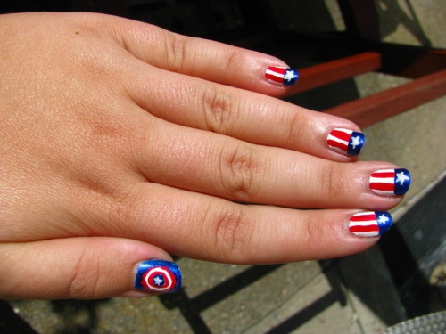 chirastremortales:  Cap nails!  These actually ended up being done over a couple days, to make sure everything was dry before the next layer went on. Also, I never want to have to paint stars that small ever again. Blue is Finger Paint's Cerulean Seascape, red is OPI's Color So Hot it Berns, and white is Orly's White Out.