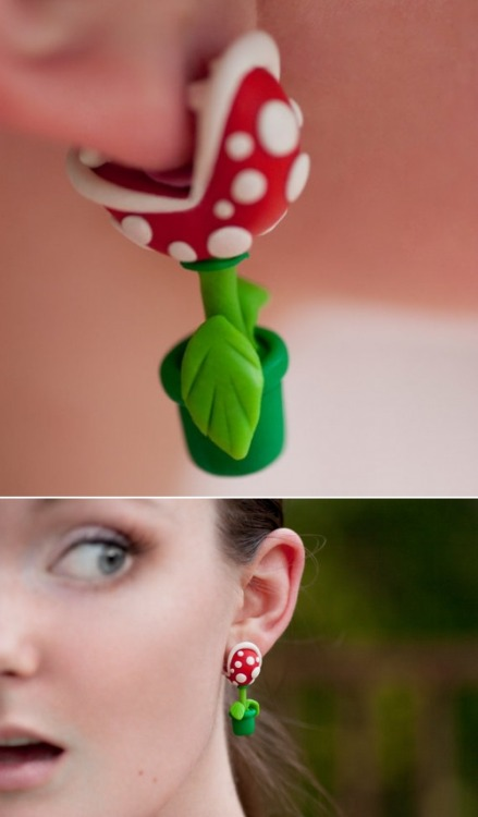 justinrampage:  Let these Mushroom Kingdom piranha plant earrings munch on your earlobe while looking like a true geek! On at Elizabeth Kohn's Etsy store for $25.50. YOUCH Piranha Plant Earrings by Elizabeth Kohn / lizglizz Via: Who Killed Bambi? | thedailywhat