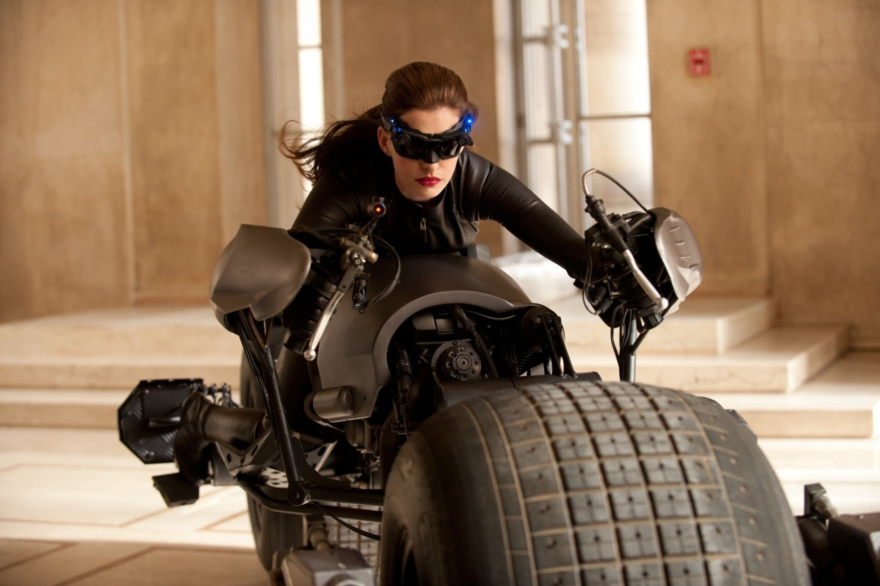 Just borrowing the bike Bruce. No ears so my guess would be this is Selina, not Catwoman. Still fuck yeah though!!