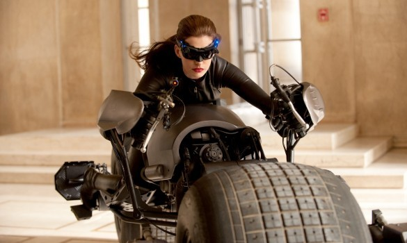 First official image of Anne Hathaway as Cat Woman You know you need better security when a cat steals your vehicle, especially when that vehicle happens to be your very special, very expensive, one-of-a-kind Bat Bike! Okay, so we don't actually know that it's stolen and she's not an actual cat but it's still very cool to see this first official photo of Anne Hathaway in character as Cat Woman in Christopher Nolan's upcoming Batman finale, The Dark Knight Rises! What do you think of Cat Woman's new look? Do you think Hathaway will do a better job than her predecessors?
