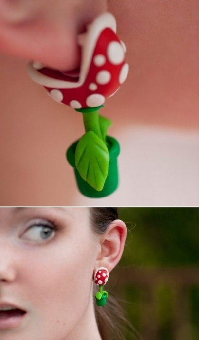 iheartgeek:  galaxynextdoor:  Mario's piranha plants can surface at any moment and anywhere… even your ears.  Well, I really fucking want these.