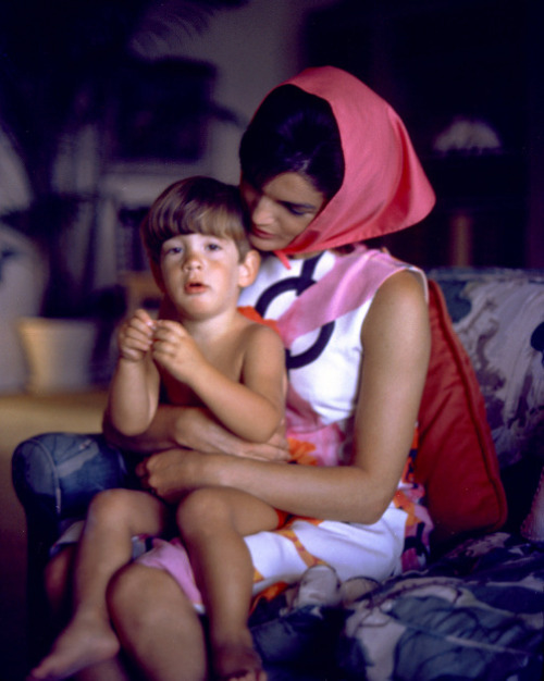 jackandjackie:  Jacqueline Kennedy wearing a Pucci creation with her son, John F. Kennedy Jr., during the summer in Palm Beach, 1963. Photographed by Mark Shaw.