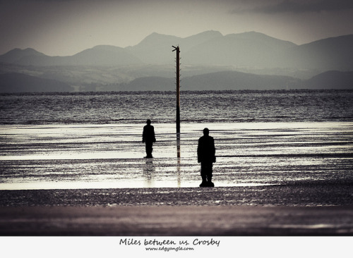 Miles  between us. Crosby on Flickr.Another 'Another place' ironman shot from Crosby beach. Here two of the 100 ironmen with a mile marker between, and the distant hills of Wales for a backdrop. Shot this evening, there was a fire up in Hightown, the grass looked as if it was on fire??… anybody know more? Fred the weather man says that we might be able to see the northen lights this evening, something to watch out for…. Thanks for viewing.Twitter |  Tumblr  |  Mymodernmet | DeviantArt | Getty  |  RedBubble  |  Youtube  |  500px