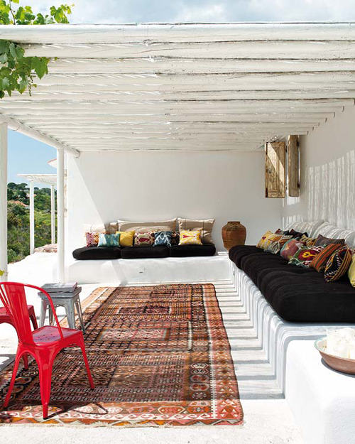 all white plaster sofas, white rough round beams as roof three85:  Via the style files