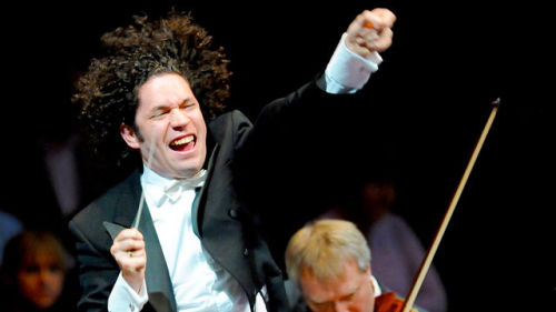 Gustavo Dudamel, The Dude of classical music, conducting the Simón Bolívar Symphony Orchestra of Venezuela - a glorious youth orchestra fostered by an incredibly successful cultural programme known as El Sistema, which offers free musical education to children in one of the poorest countries in the world.  Tonight they played Mahler's monumental Symphony No. 2 in C minor ('Resurrection') at the Royal Albert Hall as part of the BBC Proms. I couldn't go, but fortunately the whole concert is available on the BBC iPlayer. Photo via BBC - BBC Radio 3 Programmes - BBC Proms, 2011, Prom 29 - Mahler