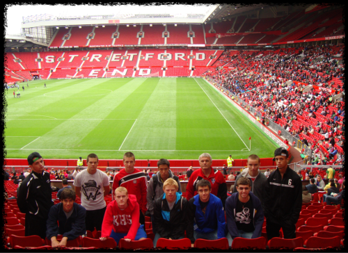 The lads with Coach Roeslein inside Old Trafford.