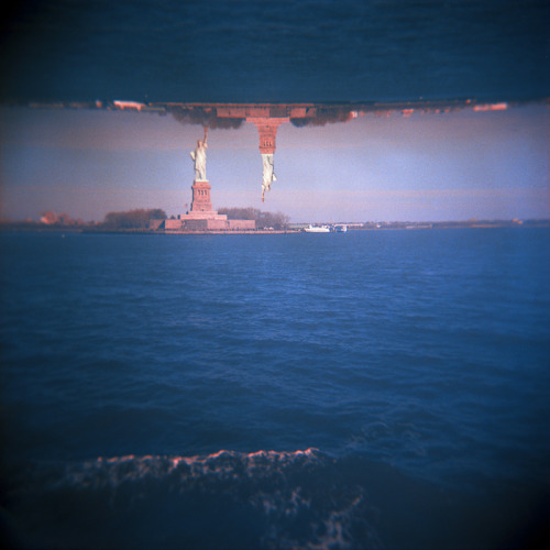 This is one of the reasons I still shoot film occasionally. Double exposures are really fun to do. Since it's film you never are really sure what you end up with, until you develop it. Patricia Dries took this double exposure of the Statue of Liberty in New York using a holga and kodak film. (via dA: New York, New York V by ~PatriciaD)