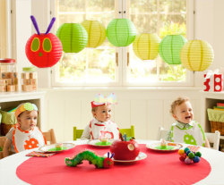 "falling-in-love-tomorrow:  DIY: A Very Hungry Caterpillar birthday party lanterns   Tools and Materials One sheet each green and yellow cardstock Two purple pipe cleaners (or chenille stems) One 8"" decorative paper lantern in red Six 8"" decorative paper lanterns in two shades of green Clear fishing line Scissors Hot glue gun  And a lot of other handy tips for planning a Very Hungry Caterpillar birthday party at Pottery Barn."