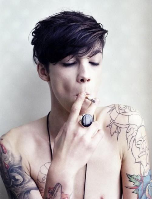 At first I thought, hot lesbian :) ……and then I thought, beautiful young man? I had to look a little harder. This is a guy btw.